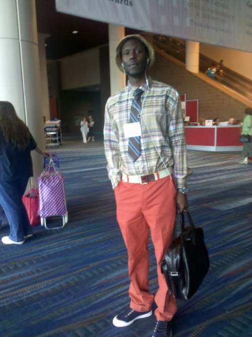 "I caught this fly dude strolling through the convention center. Unfortunately I had already accosted him by running at him full speed while shouting, ""My man! Hey…Styles, wait…come back!"" so I missed the rest of the relevant details. Hopefully he'll see this and let us know who he is."