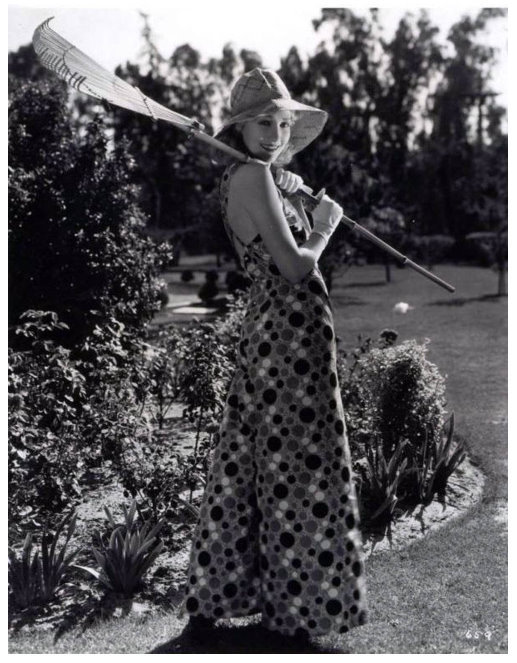 "Proof that 1930s ""beach"" pajamas (or pyjamas) were not only worn at the beach.  This gal is wearing 'em like I do sometimes: while puttering in the garden!"
