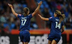 fuckyeahwomensfootball:  France's striker Gaetane Thiney (L) is congratulated by France's Louisa Necib after scoring the 2-0 during the group A match of the FIFA women's football World Cup Canada vs France on June 30, 2011 in Bochum, western Germany. AFP PHOTO / PATRIK STOLLARZ (via World Soccer - Photo Gallery - Yahoo! Sports)