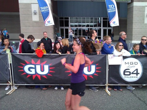 "Me at the Seattle Rock 'n' Roll Marathon on Saturday. Smiling because I am like three steps from the finish line. As my friend Becca wisely points out, ""If you run faster, you'll be done faster!"""