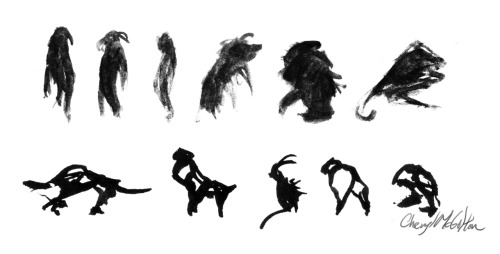 Some silhouettes of some creatures done in ink.