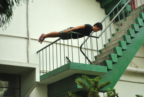 Planking in La Salle Velasco building fire escape, DLSU Manila.