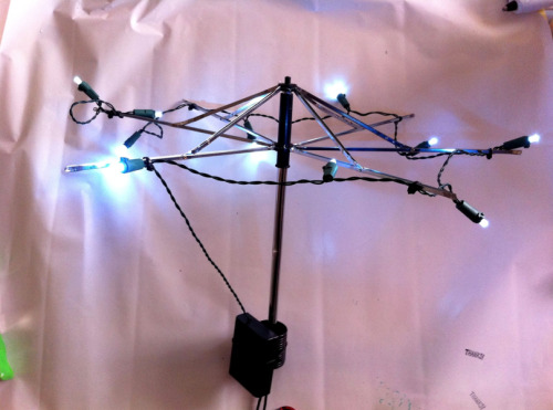 Attach a set of battery powered LED lights to a stripped umbrella frame and you have yourself a handy DIY camping chandelier!