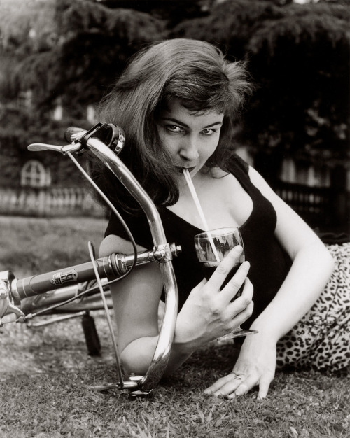 ridesabike:  Adrienne Corri curls up with a bike.