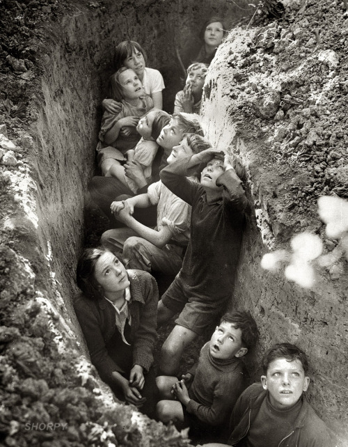"luzfosca:  ""Battle of Britain. Children in an English bomb shelter."" England, 1940-41 From British Information Service/U.S. Office of War Information Thanks to Shorpy Historic Photo Archive - View full size"