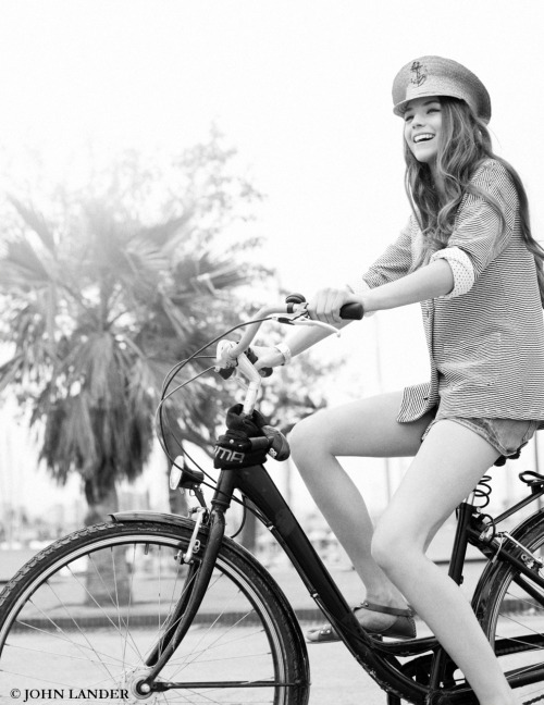 Girl on bike in Barcelona photo : John Lander