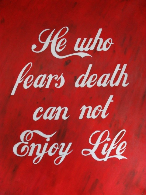 "Enjoy Life - Acrylic/oil on canvas. This is a painting I decided to start after picking up a book called 'Street Knowledge' which features street artists and movements. I started reading it as I've never particularly looked into street art subculture, but I admire the idealogy that is behind it. I believe street art is often dismissed as immature or low brow (or as a one man movement invented by Banksy?) and this is exactly why I wanted to learn from it.I became particularly interested in a movement the book referred to as 'culture jamming', or 'brandalism'. It's described as 'one of the more exciting and ingenious elements of street culture' and is basically the idea that people can respond to advertisements that are forced into our lives, by personally responding to them/altering them.  One community, on the website areyougeneric.org promote the artistic side to culture jamming. It is a group who counteract unethical corporations, censorship and biased media, and the website says their heroes are 'discussion, independent thought and creation'. After spending some time reading about the ideas behind their creations, I decided to do a similar piece. I took inspiration from a Channel 4 Dispatches documentary on the Coca Cola company which was aired a few years ago, about how unethical the company actually is. Despite Coca Cola being one of the most iconic and successful brands throughout the 20th and 21st centuries, the documentary uncovered how the corporation exploit both workers and nearby citizens of the factories, have a history of strong racism (to the point where Martin Luther King urged people not to buy Coca Cola products!) were involved in nazism, and have caused significant environmental damage to poorer countries. However despite these past and current crimes and violations, the perception of the Coca Cola company is still one of happiness and freedom. After watching this documentary, I was in such a rage that I made an effort to boycott Coca Cola and other Coca Cola Co. products, and did successfully for three years… However, it's quite a difficult thing to do! I wanted to directly reference some of Coca Cola's slogans ('The Coke side of life', 'Enjoy Coca Cola' etc)  into my  piece, but wasn't quite sure how to until I was brainstorming while listening to Icelandic band 'Dead Skeletons'. Dead Skeletons play dark rock 'n' roll with a spiritual twist. Their songs take inspiration from esoteric sayings from Tibetan dancers, and their artwork and lyrics are full of quotations from old philosophers.In the track 'Dead Mantra', there is one line repeated throughout; 'He who fears death can not enjoy life'. In my mind, this fitted perfectly.I decided to have this line painted in Coca Cola's own image; White wording with the iconic firetruck red background. I painted the background more disheveled and deteriorated, representing the struggles and hardships faced by those who have suffered to such a huge coporation, and I capitalised the words 'Enjoy Life', to draw the similarity to the Coca Cola slogans and add a wee bit of sarcasm to the piece.  Being informed and questioning the practices of advertising multinational corporations and teaching others that it's okay to do so is an important part of modern society.  Ironically, I'm going to end this with a quote on advertisers/culture jamming from Banksy:  ""Any advert in a public space that gives you no choice whether you see it or not is yours. It's yours to take, re-arrange and re-use. You can do whatever you like with it. Asking for permission is like asking to keep a rock someone just threw  at your head. You owe the companies nothing. Less than nothing, you especially don't owe them any courtesy. They owe you. They have re-arranged the world to put themselves in front of you. They never asked for your permission, don't even start asking for theirs."" — Banksy"