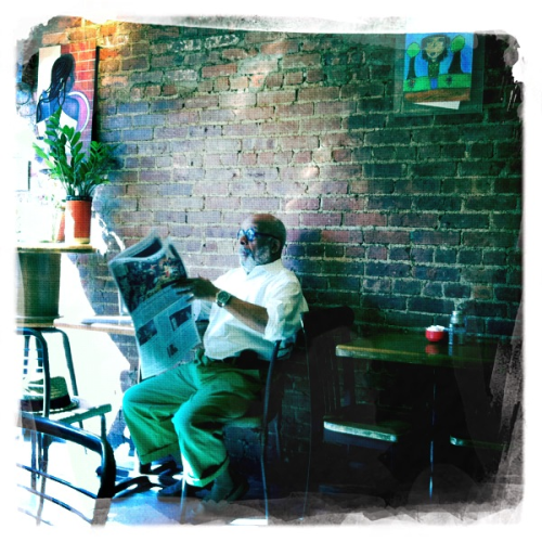 focusandrefocus:  Man reading newspaper