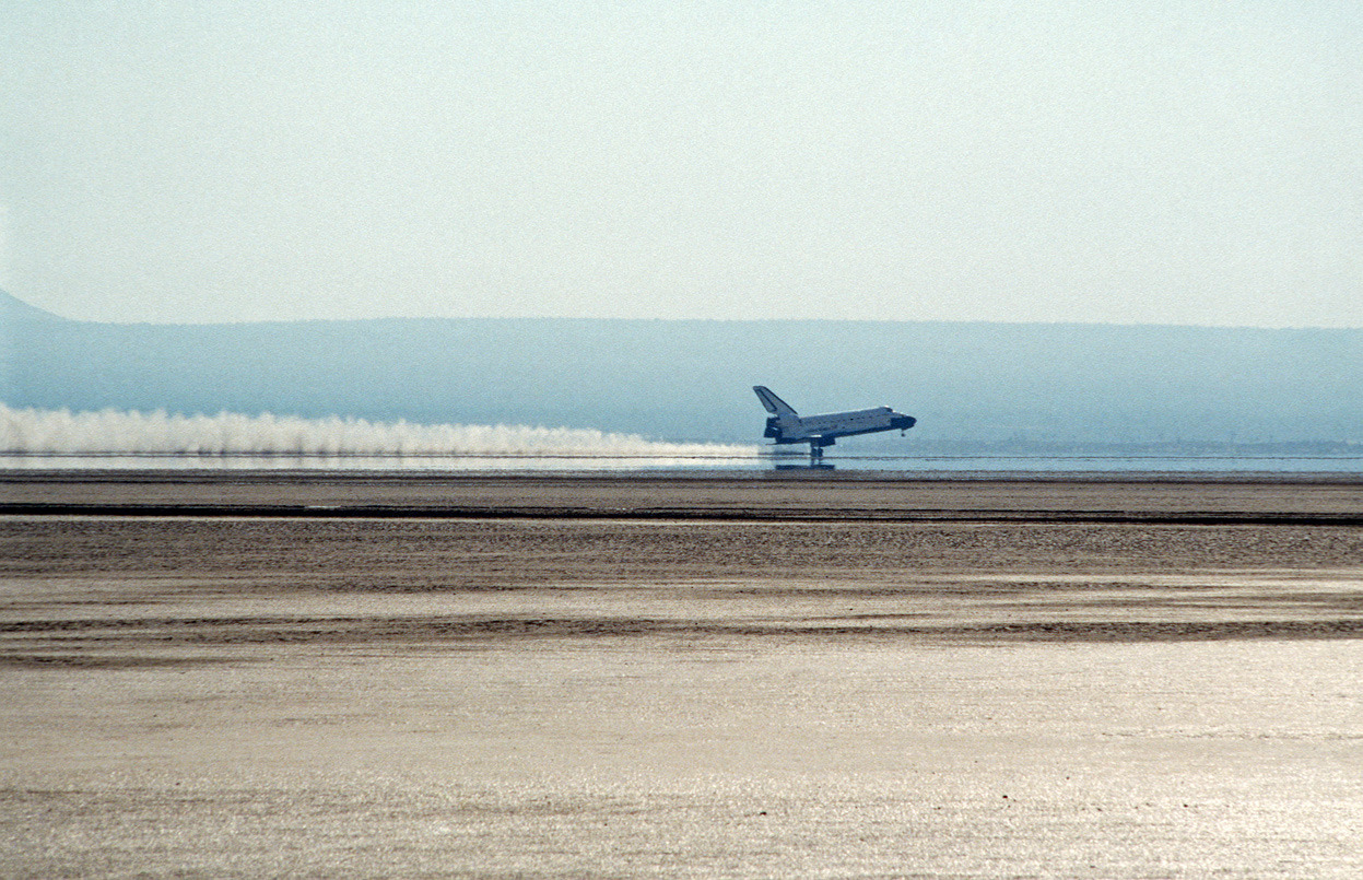 The space shuttle orbiter Discovery lands on Edwards Air Force Base in California, following completion of the 26th Space Transportation System mission. (Tech. Sgt. Mike Haggerty/USAF)