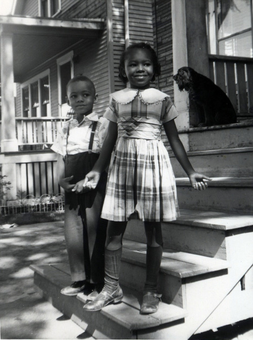 Brother & Sister pose on the porch. 1950's
