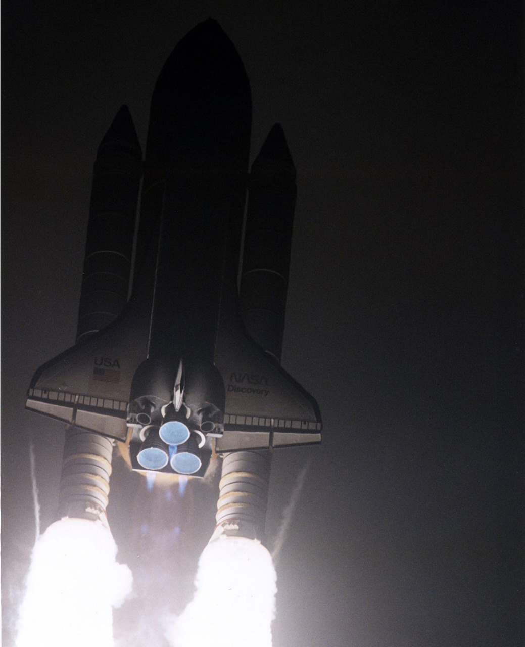 The Space Shuttle Discovery cuts a bright swath through the early-morning darkness as it lifts off from Launch Pad 39A on a scheduled 10-day flight to service the Hubble Space Telescope. (NASA)