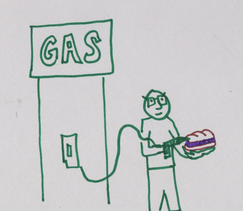 Man Fills Sandwich at Gas Pump.