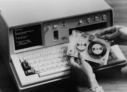 IBM PORTABLE COMPUTER (1975) IBM introduced the 5100 Portable Computer in September 1975. The machine weighed around 50 pounds and was a little larger than a typewriter. Though it may appear clunky compared with today's computers, the 5100 was significantly smaller than the era's other computers with similar capabilities; it could use both the APL and BASIC programming languages and could be equipped with up to 64 kilobytes of memory. Fully loaded, the 5100 cost around $20,000. Technology Review: 100 Years of IBM in Pictures.