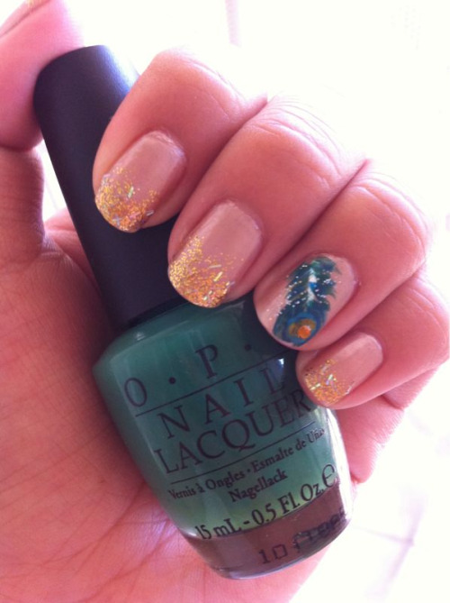 annett3:  Glitter Gradient Peacock Feather Accent Nails Base: OPI - Cosmo-Not Tonight Honey! Glitter: New York Summer - Vegas Gold Feather: OPI - Jade is the New Black China glaze - Custom Kicks F21 Love & Beauty - Blue and Yellow