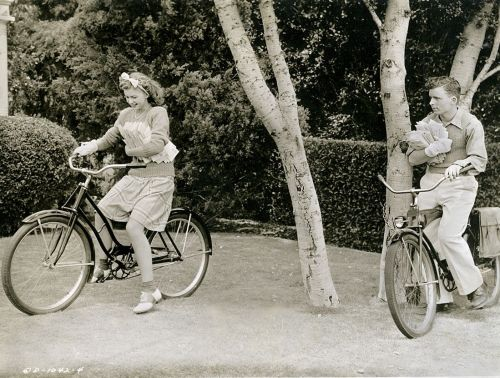 Louise Erickson and Bob Crosby ride bikes. And deliver mail. And wear funny bandages on their hands.