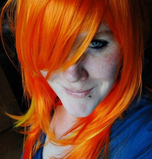 Want orange hair with yellow streaks without the harsh chemicals? Wig available here.