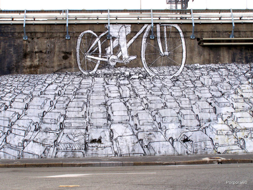 this combines so many things that i love (bikes! street art! what looks like someone in a skirt riding a bike!)