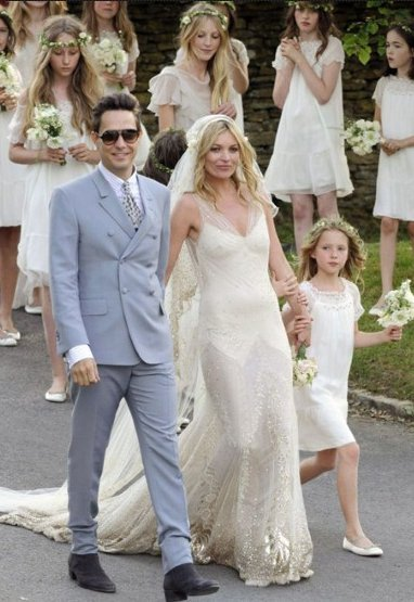 Kate Moss wears a John Galliano vintage-inspired, slim-fitting, floor-length dress featuring a smattering of sequins and delicate sheer panelling Wedding Dress and Manolo Blahnik shoes while his husband, Hince, double-breasted Yves Saint Laurent suit.   (Re-posted onStylePage)