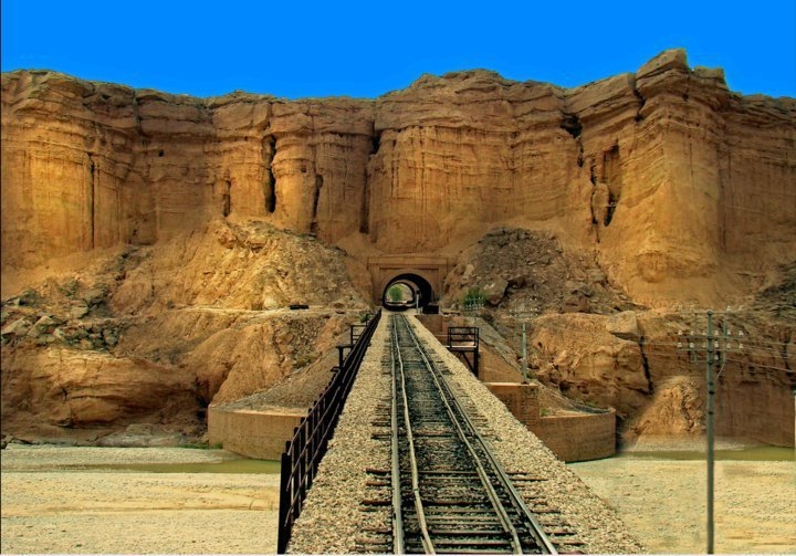 "Rohri to Quetta:  This  is an amazing view of a tunnel and bridge over a river on the railway  track from ""Rohri to Quetta"". This track passes through 20 tunnels and  over 368 bridges. It's the longest Railway gradient of world, and most  scenic Railway ride of Asia. This track also extends from Quetta to  Turkey through Iran!"