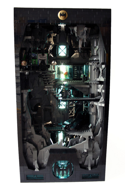 "itlego:  LEGO Batcave  - by Alex Schranz Comments: ""Approximately 8000 - 9000 parts been terminated to build the cave. 68 bricks in height. The base is 40 x 40 studs.  In the back there is a neon lamp to light up the cave. Took me about a week to get this done""."