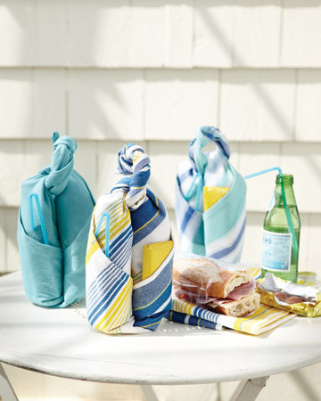 These neat bundles have everything you need for a picnic meal, including a handle to transport them. With a few quick folds and a knot, you can transform a dish towel into a carrier for a sandwich and drink. Once you're at your destination, use the towel as a place mat or napkin. How-to's are here!