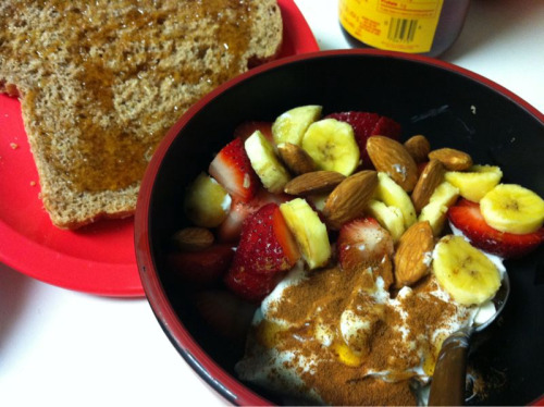 Too lazy to make a parfait? Make a yogurt bowl!  greek yogurt cinnamon bananas strawberries almonds whole grain toast drizzled with honey