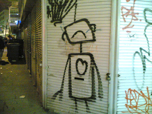 Sad robot graffiti  source: theshoez (Flickr)