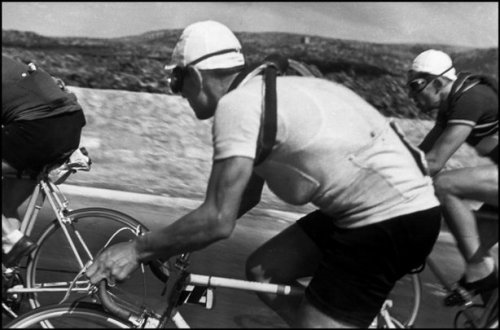 queenstage:  Tour de France by Robert Capa, 1935. Note the flask in the jersey pocket. What's in it?? (Photo via Slate)