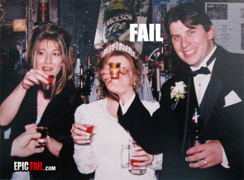 Wedding Photo #Fail lol we can see how much he cares for his new wife. Wife vs liquor? He chooses liquor.