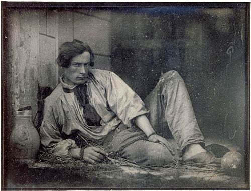 Louis Dodier, photographed as a prisoner, 1847. Photograph by Louis Adolphe Humbert de Molard. Dodier was Humbert de Molard's steward, and the photographer would frequently have his friends, family, and servants pose in romantic attitudes. (Musee D'Orsay)