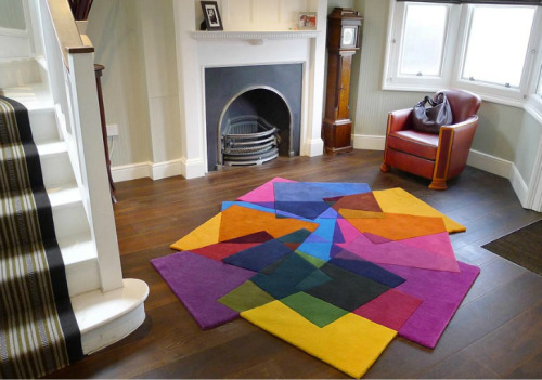 What a great way to brighten up a room! Overlaying collage rug by Sonya Winner