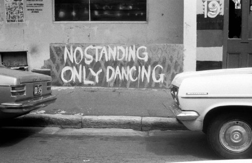 """No Standing, Only Dancing"" by Rennie Ellis, 1974  Australian photographer Rennie Ellis (1940-2003), manifested his lust for life in the incredibly raw and titillating images of '70s & '8os that perfectly capture the heyday of Rock 'n' Roll rebellion, sexual experimentation, high fashion & tomfoolery.  Don't miss the pic of Bon Scott & Angus Young."
