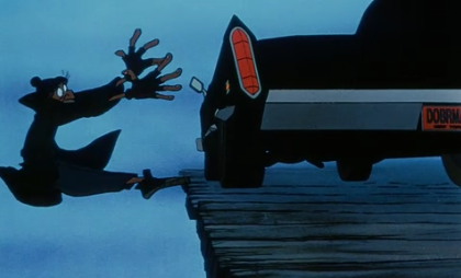 Fagin looses balance and reaches out to Sykes' car, from Disney's Oliver and Company