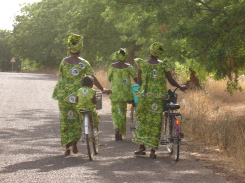 Every International Women's Day, the ladies of Burkina celebrate by participating in dances, sports and other festivities. Here, my friends from village make their way to our closest city for the March 8, 2009 activities. Each year, the country produces a new fabric design to celebrate the day and women rush to the textile retailers and tailors to have outfits made in time for the holiday.  Peace Corps Health Volunteer Karla Morrison Burkina Faso, 2009