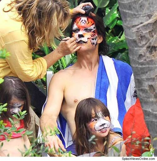 speriod:  Here's Tom Cruise, getting his face painted like a tiger.