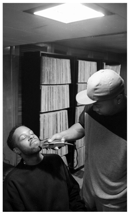 okayplayer:  Dilla gets a shape up by Frank (of Frank N Dank) in his Detroit basement studio, photo by Mpozi
