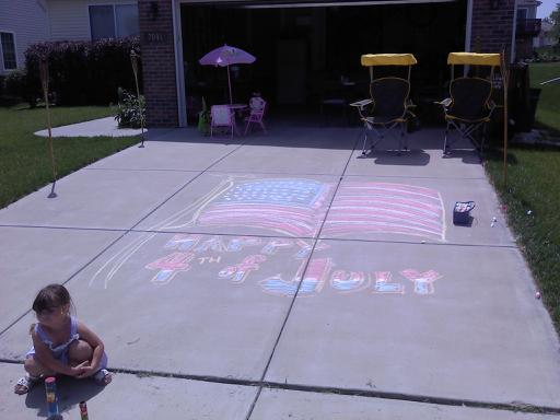 Image description: A young girl draws a mural on her driveway to greet visitors in Lincoln, Nebraska. We asked you to share your best photos from your Fourth of July celebrations. Thanks to B. Curtin who shared this image with us on Twitter.
