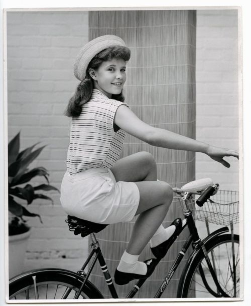 Reba Waters rides a bike.