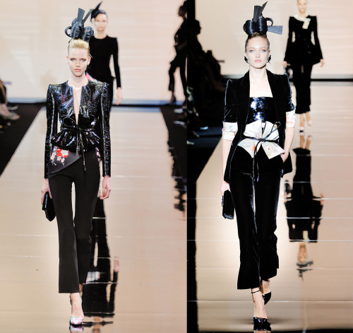 darklamb:  Armani Prive Autumn/Winter 2011-2012 (images via vogue.com) Two of the really, very on-point, very Armani, Japanese-inspired looks that walked down the runway in this show. I do love when Armani does Asian references because it's just done so well. These trousers are flawless and the length of the hem at the ankle- perfect (though rather hard to wear unless one has extremely long stems). I am not one to condone the use of velvet, but this black silk velvet is done so well, cut so perfectly it's almost feline. You can just feeeel it absorbing all the light in the room, but in a good way.  Cinched waists with belts that recall obi's, the headdresses that are based on ikebana flower arranging, and the soft floral prints ground this firmly as an homage to Japanese costume but are not overly costume-y. They look very chic and very fresh (although if I had one critique it would be that some of the floral prints look a bit tired or cliche`). Brilliantly, Armani kept the color palette nice and tight (black, white, pink, orange). This could have ended up a big old mess in someone else's hands (Dior, anyone?) but the Armani atelier executes this concept perfectly. A+ (and it's not really even my taste).