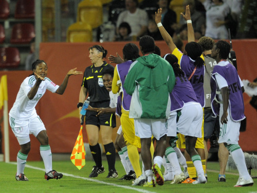 Nigeria´s players celebrate after scoring during the Canada vs Nigeria Group A match of the FIFA women's football World Cup on July 5, 2011 in Dresden, eastern Germany. Nigeria won the match 0-1. AFP PHOTO / ROBERT MICHAEL (via World Soccer - Photo Gallery - Yahoo! Sports)