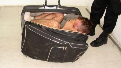 Packed And Ready - Woman Hides Man in SUITCASE in Prison Break Attempt (Fox News Latino) — For most people, it's hard enough to pack a suitcase with clothes – let alone your husband.  Police say a woman was caught trying to sneak her common-law-husband out of a Mexican prison in a suitcase following a conjugal visit. A spokesman for police in the Caribbean state of Quintana Roo says staff at the prison in Chetumal noticed that the woman seemed nervous and was pulling a black, wheeled suitcase that looked bulky. Spokesman Gerardo Campos said Monday that prison guards checked the bag of 19-year-old Maria del Mar Arjona and found inmate Juan Ramírez Tijerina curled up inside in the fetal position. Ramírez is serving a 20-year sentence for a 2007 conviction for illegal weapons possession. Arjona was arrested and charges are pending. This is already the second incident this year involving people finding their way inside suitcases. In Spain, a man was caught curled-up inside a large suitcase in an attempt to steal from other people's luggage. Original Article