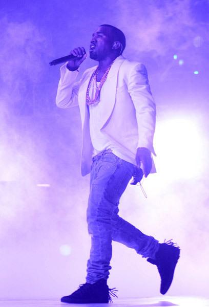 Kanye west in white shawl collared blazer  Balmain belt andjeans ($890) Trussardi 1911 fringe sneakers