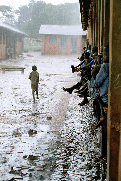 "Running for cover, Nawanyago Primary School, Uganda ""This photo was taken on my last day working as a teacher at Nawanyago Primary School, Uganda.  The heavens opened and everyone ran for cover"" By: Richard Duke"