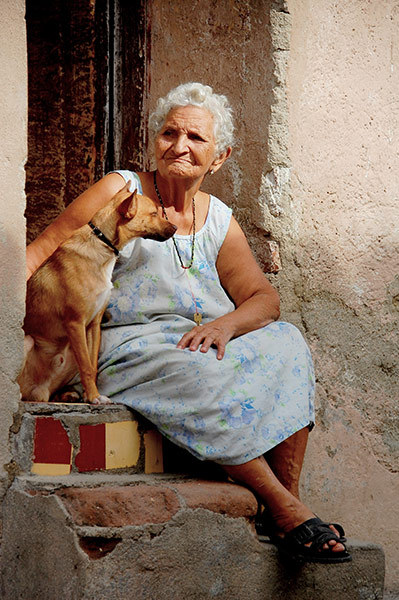 "Day go by, Santa Clara, Cuba ""A woman and her pet watching the day go by in front of her house in Santa Clara, Cuba"" By: Nicholas Lam"