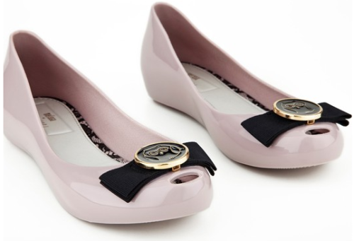 "New plastic shoes from Melissa! These are one of two designs by Jason Wu, who has inexplicably used fur in past collections, but we'll forgive him a little for that because these are super-duper adorable. Can't tell you the cost because they're not available yet, but according to Fashionologie you'll be able to get them in black, burgundy, ""nude,"" and ""transparent gray,"" and lined with ""pink and black lace."" I am not crazy for owls, but I love these shoes' weird soap-dish-y form and teeny tiny peep toes—almost cutesy, but I bet the hideousness of ""transparent gray"" will bring them into ugly-cuteness. Either way, SHOES I LOVE SHOES."