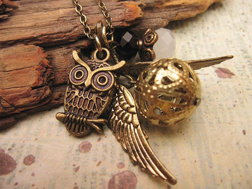 colordeangel:  I have to have an Owl Necklace! *-*  owl and the golden snitch <3