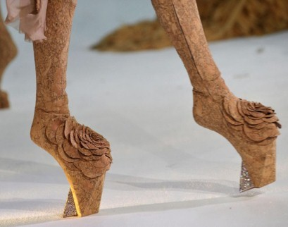 "LADYgoesGAGAforCOUTURETimber legs? Five inch platforms? Moulded Sellotape jackets? Lady Gaga's inspiration is everywhere on day one of Paris Haute Couture.Dutch fashion designer, Jan Taminiau, whose clients range from Dutch royalty to Pop Queen, Gaga herself, created what looked like stack cork platforms with grown-on boots for his Paris show, entitled Honor To Women today.""With her timber legs, she moves slowly through the wood. She is inwardly strong, walking with her head up, proud of herself."" ""Playing with new silhouettes - which is where the staggering five inch cork platforms came into it - alters the body verticality,"" said the designer. Taminiau's idea being, by stretching a woman skywards she becomes almost an extension of nature, a woodland being. Geddit?"