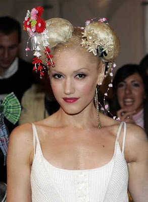 THISSHITISBANANAS! B.A.N.A.N.A.S!Not only is Gwen Stefani one of the most glamorous icons of recent times, but she's also one of the most diverse. From her career's early beginnings with ska rock band No Doubt in the late 1980s, Gwen has gone on to establish herself as a captivating frontwoman, fantastic solo star, style icon and fashion designer - all with overwhelming success - not to mention her roles as a wife and Hot mumma! we salute you!