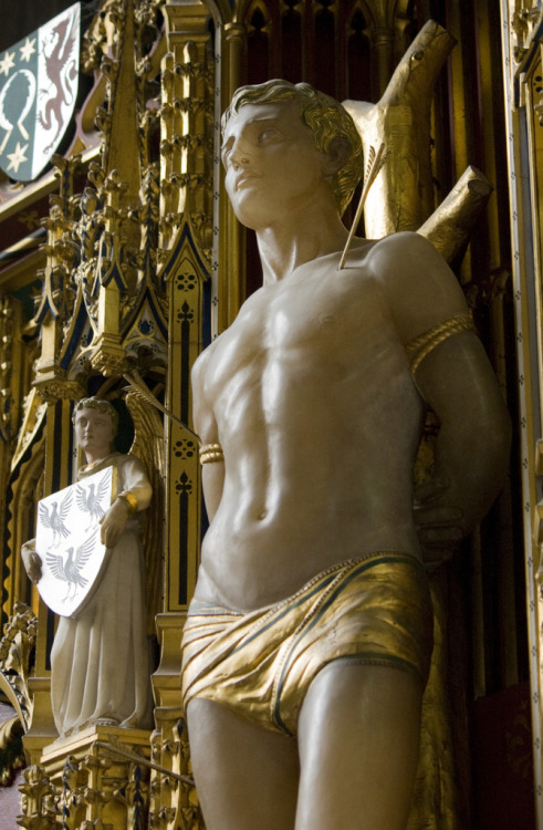 As Maymay has pointed out, St. Sebastian is a major male subject of Catholic sadoeroticism.  He's also a little more accessible than the other main subject: Jesus.  Here Sebastian is looking pretty calm in alabaster and gold. I'm guessing this is from the 1900s.  Comper would have been the designer, not the sculptor. signorcasaubon:  A statue of Saint Sebastian in an English church, by Sir Ninian Comper