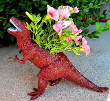 dizzymaiden:  Cute way to use kids old toys - or have a reason to buy a t-rex! wantonredhead:  Dinosaur Planter Tutorial